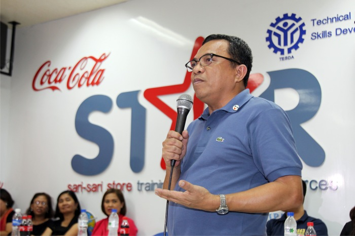 Labor Undersecretary Nicon Fameronag congratulates the first batch of WOMEN REACH! graduates, 43 former OFWs and immediate family members of OFWs, during a ceremony at the STAR Center for Excellence facility at the TESDA Women's Center.
