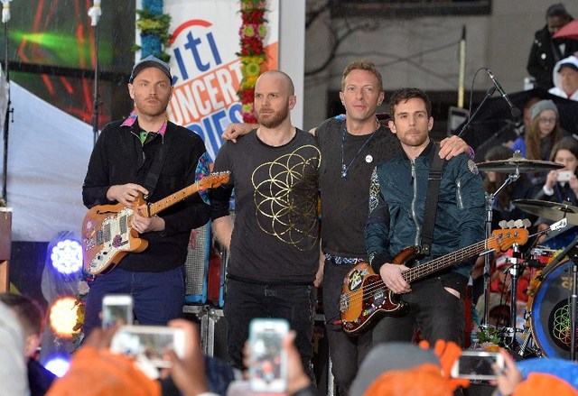 COLDPLAY IN MANILA. Photo shows guitarist Jonny Buckland, drummer Will Champion, singer Chris Martin, and bassist Guy Berryman of Coldplay perform on NBC's 'Today' at Rockefeller Plaza on March 14, 2016 in New York City. The group will perform in Manila on April 4, 2017. Photo by Slaven Vlasic/Getty Images/AFP