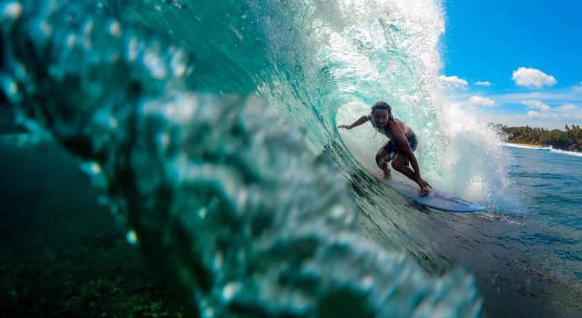 Surfer Luke Landrigan riding the waves in La Union